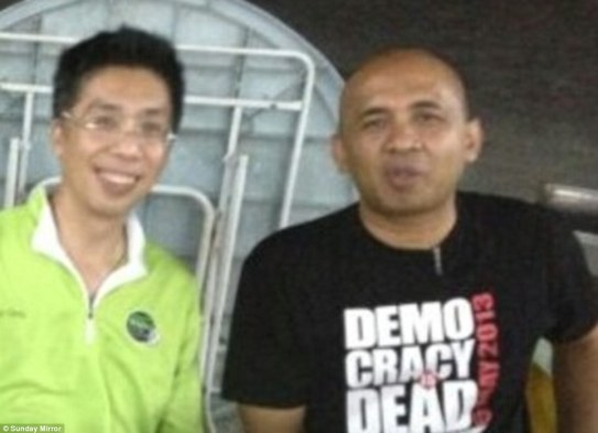 Peter Chong (left) with best friend Captain Zaharie Ahmad Shah, pilot of the missing Malaysia Airlines plane. He is pictured in a T-shirt with a Democracy is Dead slogan. Clearly, he had issues with the present Malaysian Government.