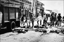 Cleanup of dead bodies left on the street following a massacre © BBC.