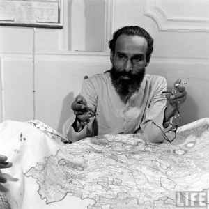 Qasim Rizvi browsing a highly detailed map of Hyderabad State. Was this the face of British Intelligence? © LIFE.