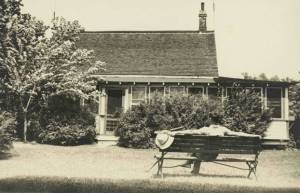 Charles Sauriol in front of the original cottage at the Forks, July 1935. City of Toronto Archives, Series 80, File 8.