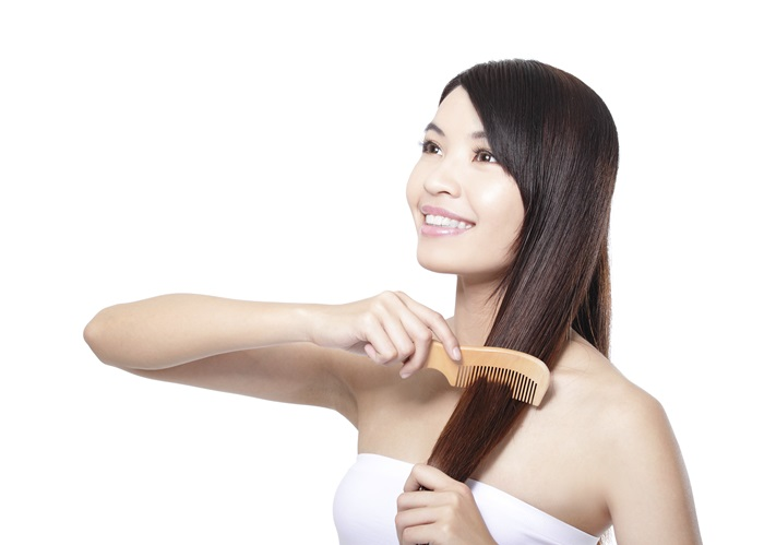portrait of a beautiful young woman comb wonderful hair isolated on whita background, asian beauty