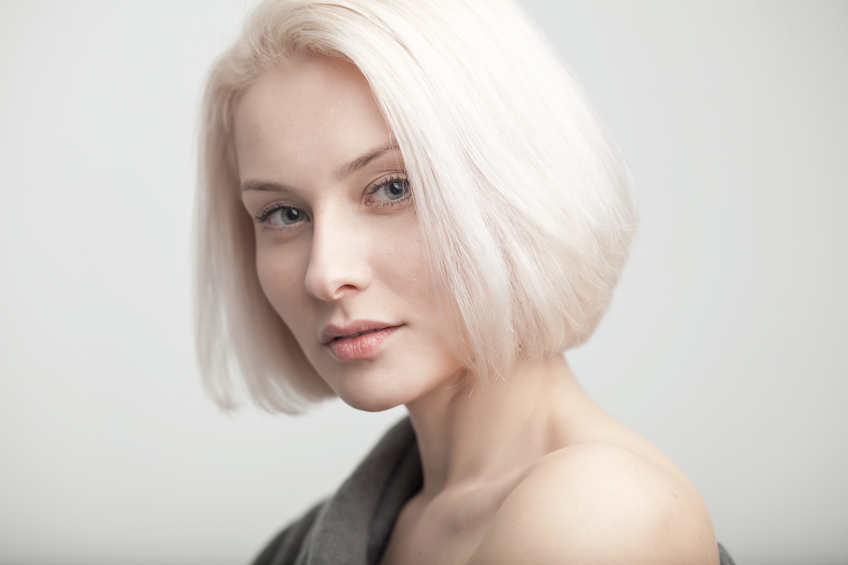 photo beauty portrait of blonde woman on gray background