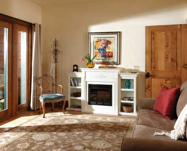elegant room in Eden Suite with electric fireplace and full size pull out sleeper couch