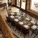 Cabin Creek Landing FAQs elegant wooden dining area for large groups with a wonderful view