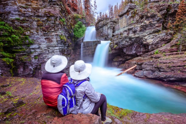 a couple looking at a beautiful water falls