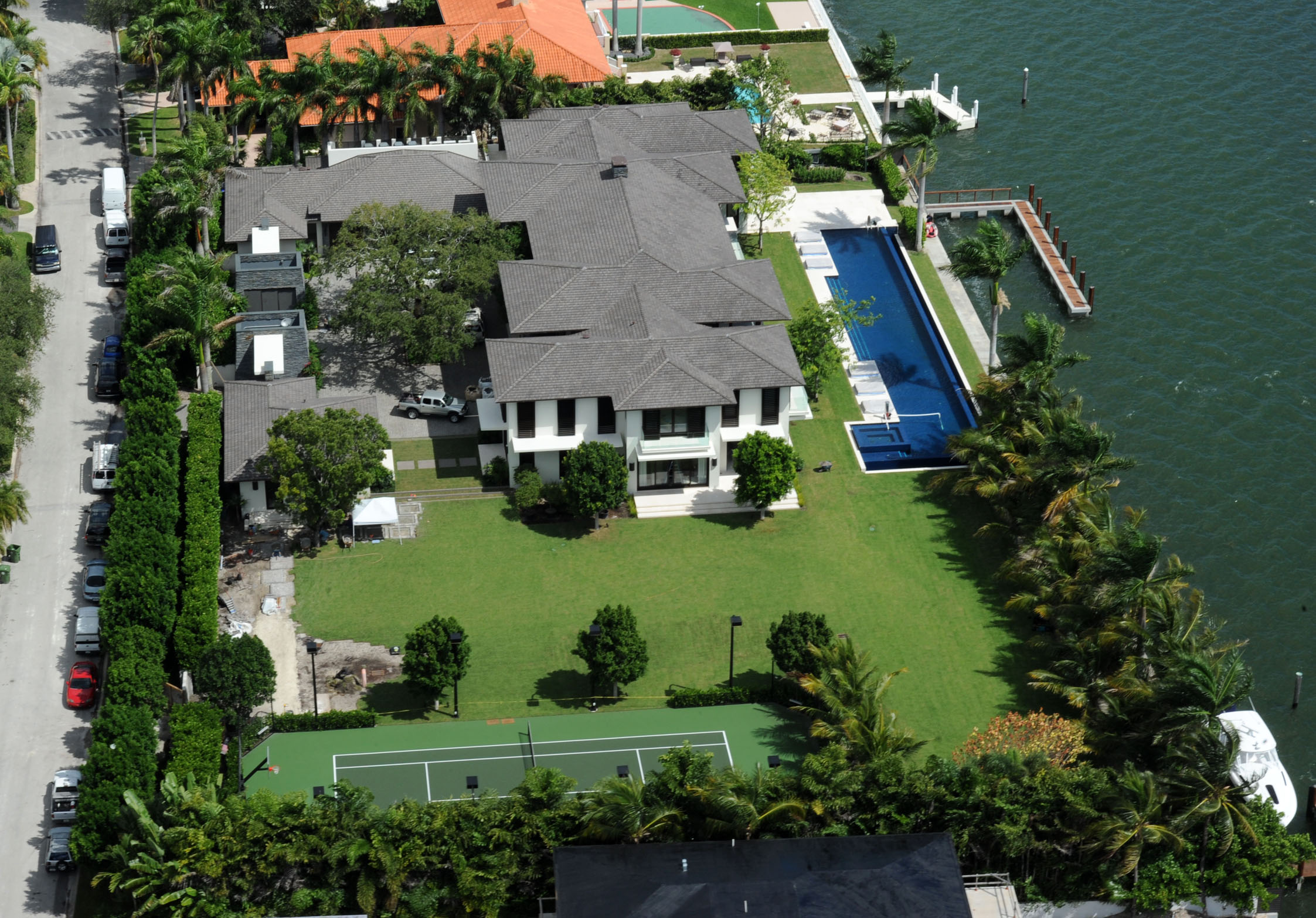 Enrique Iglesias moves into his giant mansion in Miami. The price of the new house at 4535 Sabal Palm Road was slightly more than $26 million! Miami-Dade County records show Iglesias grabbed two waterfront lots with sweeping views of Biscayne Bay and the Miami skyline in 2009 for a total $5 million. He and galpal Anna Kournikova then had a crib believed to be close to 20,000 square feet of sheer luxury built on the property, after the two existing houses were leveled. Tons of landscapers were seen on the property today finishing up the landscaping around the entire property. Pictured: Enrique Iglesias new home in Miami Ref: SPL622796 071013 Picture by: Jason Winslow / Splash News Splash News and Pictures Los Angeles:310-821-2666 New York: 212-619-2666 London: 870-934-2666 photodesk@splashnews.com
