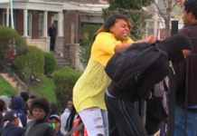 Baltimore mom pulls son out of crowd