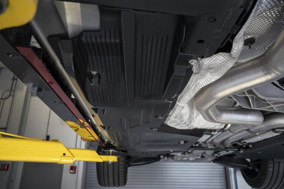 Body panels, including rear control arm covers, help to control airflow underneath the 2022 CT4-V Blackwing.