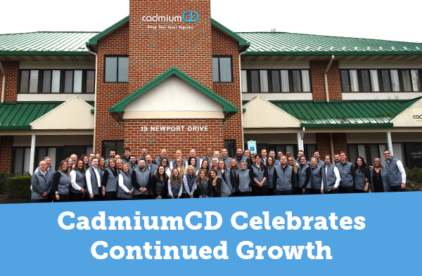 CadmiumCD team celebrating their continued growth in front of the building they now occupy in Forest Hill Maryland