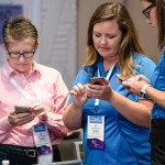 CadmiumCD employee showing CadCon attendee how sustainable an app is