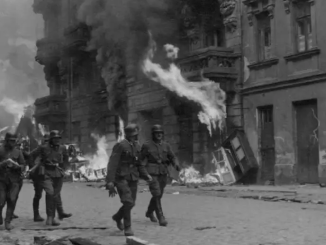 SS SOLDIERS patrol Nowolipie Street in the Warsaw Ghetto during the 1943 uprising. (photo credit: Wikimedia Commons)