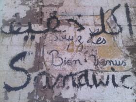 Soyez les bienvenus, sur les murs d'un restaurant à Ain El Turck (2011)