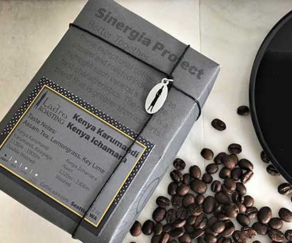 sinergia project packaged coffee from ladro roasting with coffee beans and coffee saucer from caffe ladro