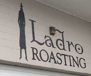Seattle coffee roaster, Ladro Roasting has its logo over the roastery loading dock