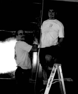 Bob Ohly and Thomas Stemple hanging lights during West Seattle Caffe Ladro construction the third of Ladro Cafes
