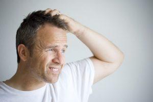 picor, escozor, irritación debido al minoxidil en loción