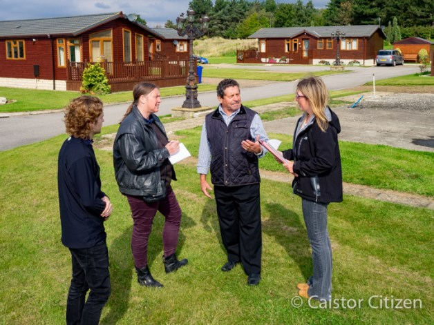 Asa and Bill Green with Rachael Bartlett talk to Shona with some of the properties in the background