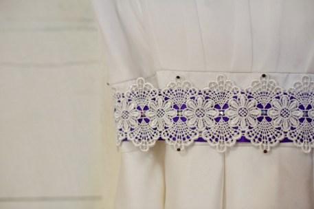 Spencer's handmade lace and purple ribbon sash