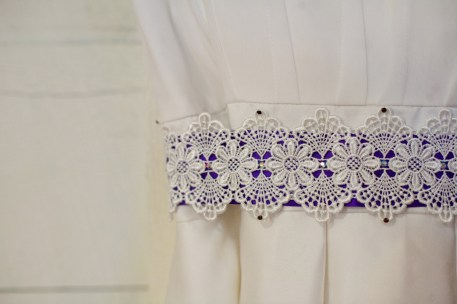 Spencer's handmade lace and purple ribbon sash