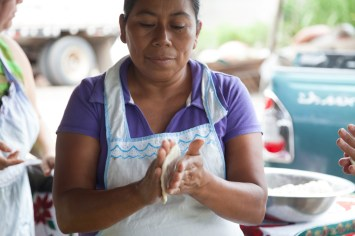 A woman making tortillas with an Ecocina stove from StoveTeam International