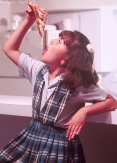 Catholic school girl eating pizza