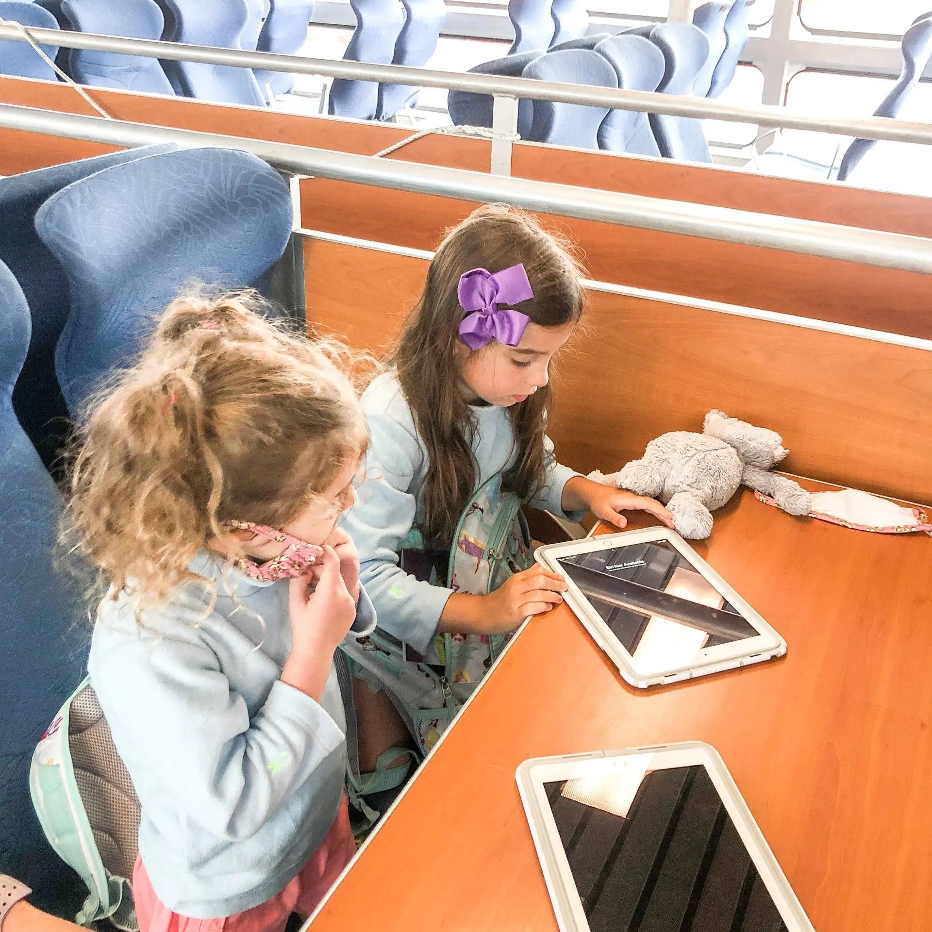 little girls on Seastreak ferry with ipads