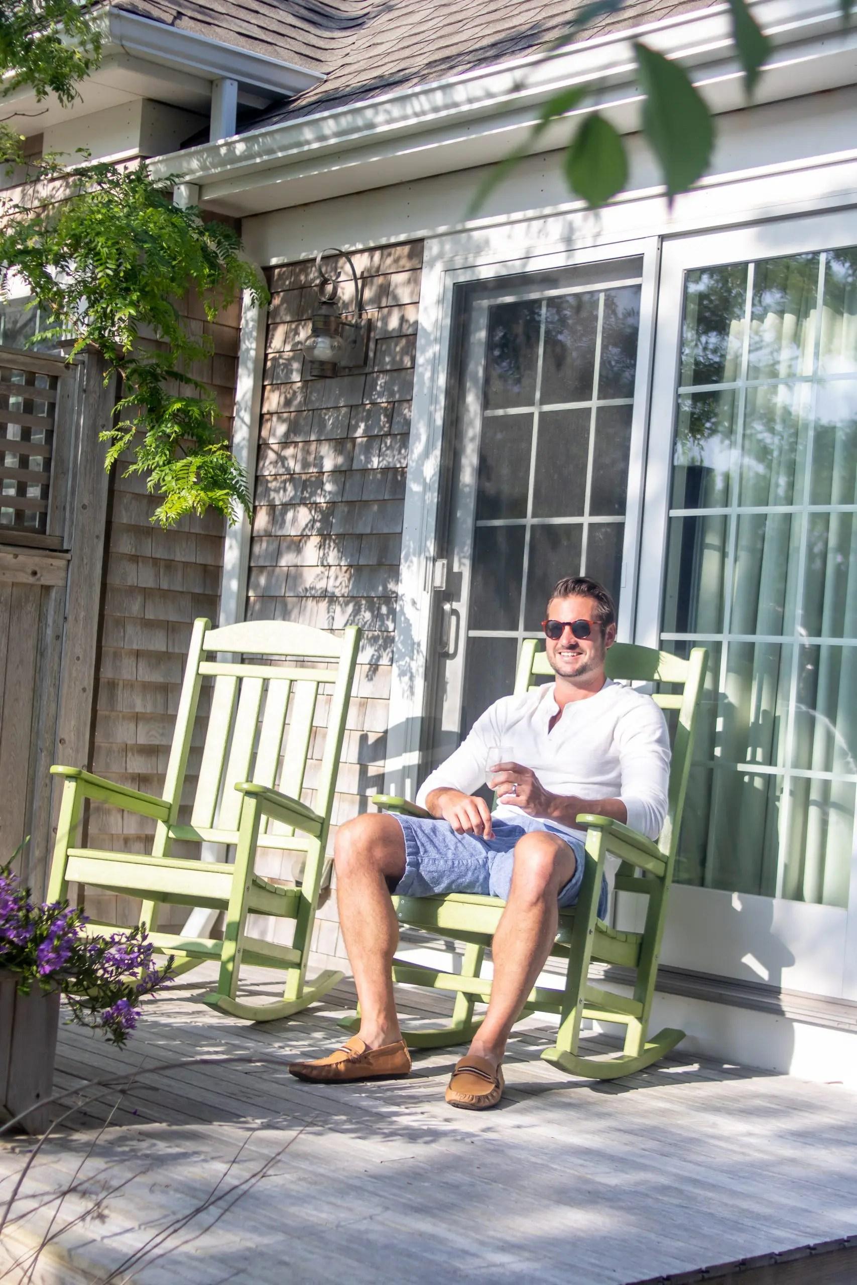 man in rocking chair at chappy cottage winnetu