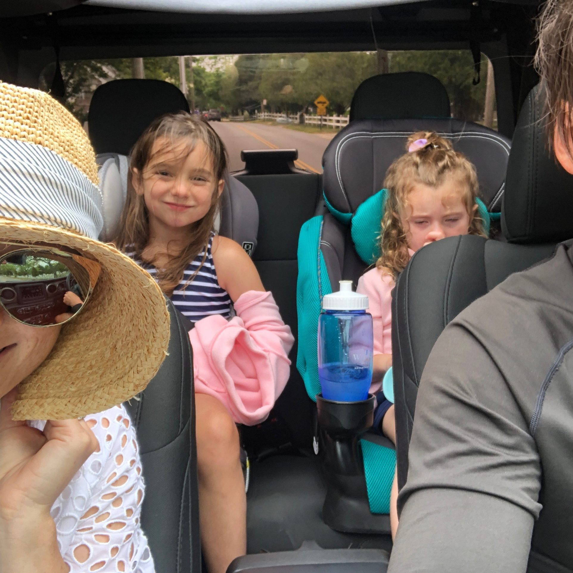 family riding in a jeep