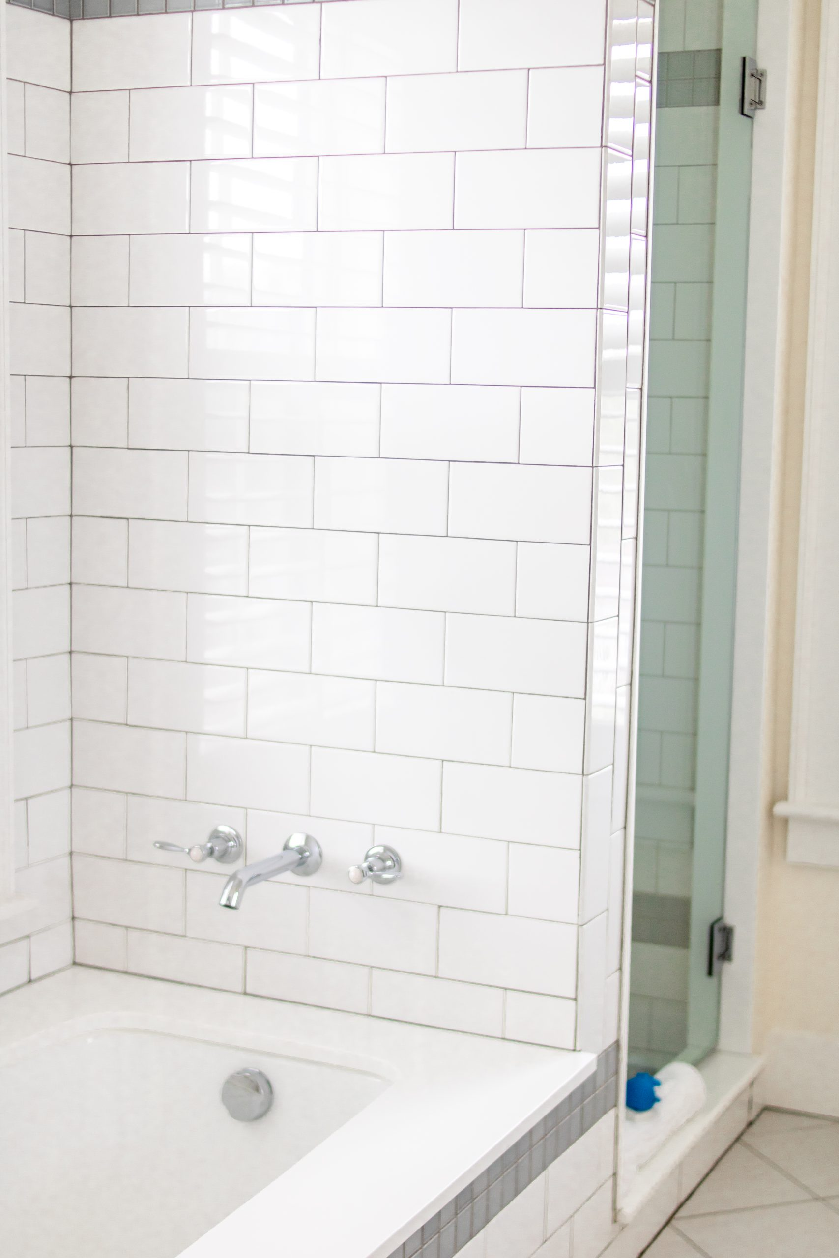 white subway tile tub next to shower at The Nantucket Hotel