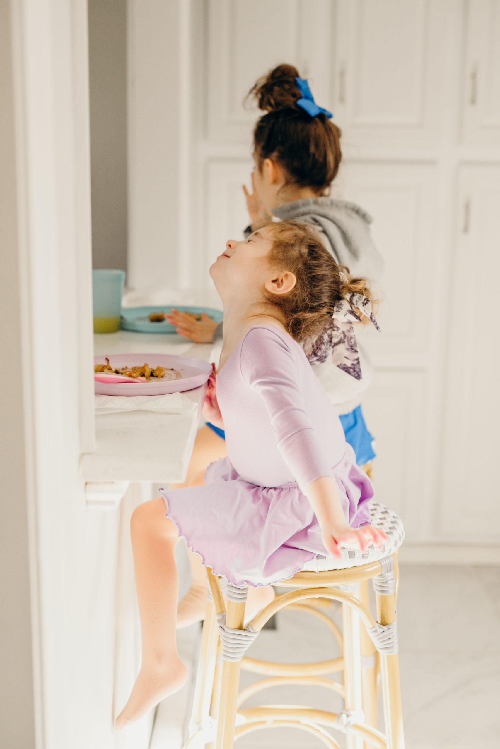 little girls sitting at breakfast bar eating pancakes on serena and lily dupe stools