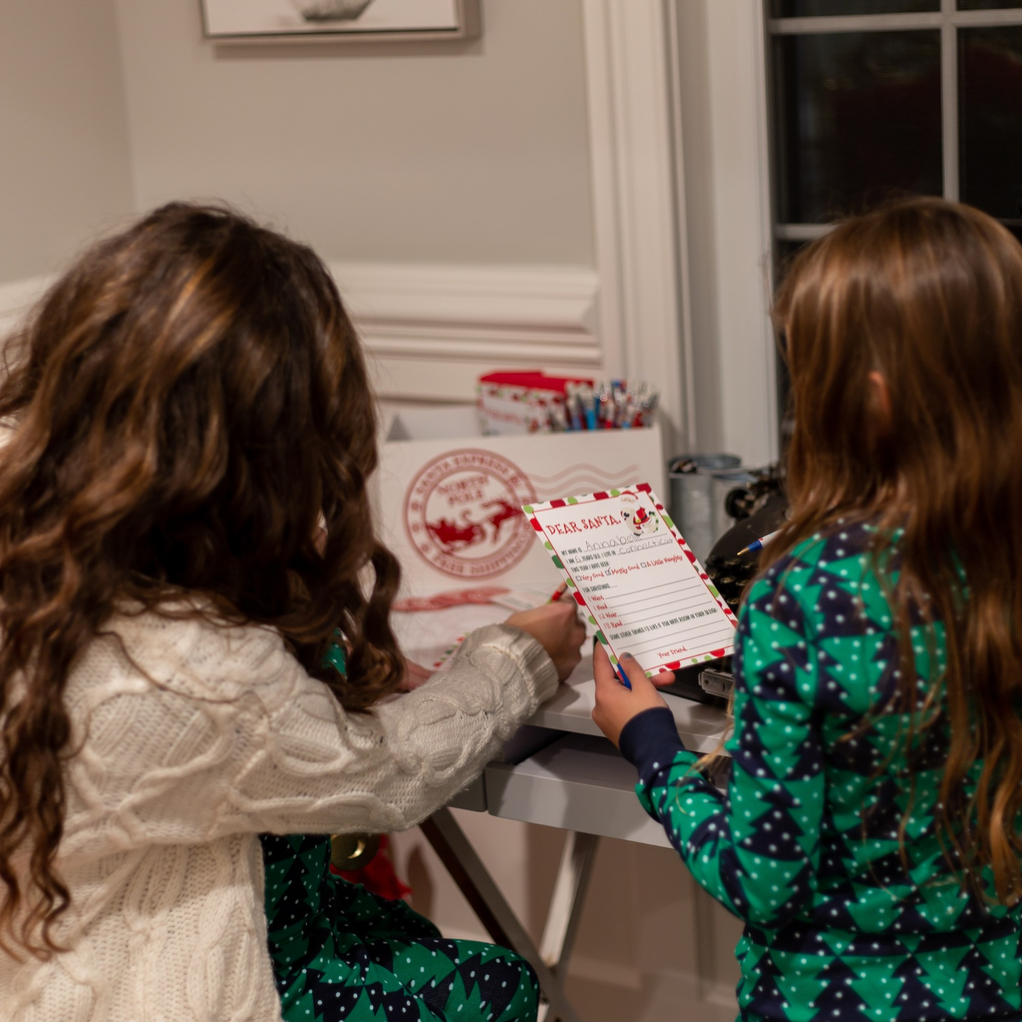 Mom and Daughter Writing Letters to Santa at the Holiday House