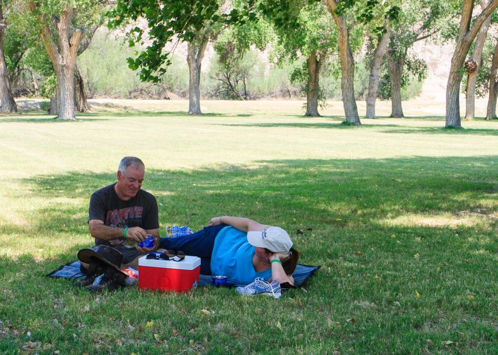 A picnic under the cottonwoods after a hot morning and drive in the desert.