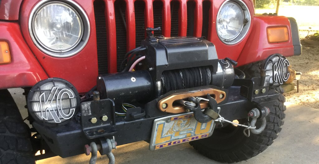 Both tow brackets are shown in this image. Each is mounted above the shackles at the top of the after-market bumper.