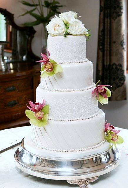 4 Tier Ivory Wedding Cake With Fan Pattern And Fresh White