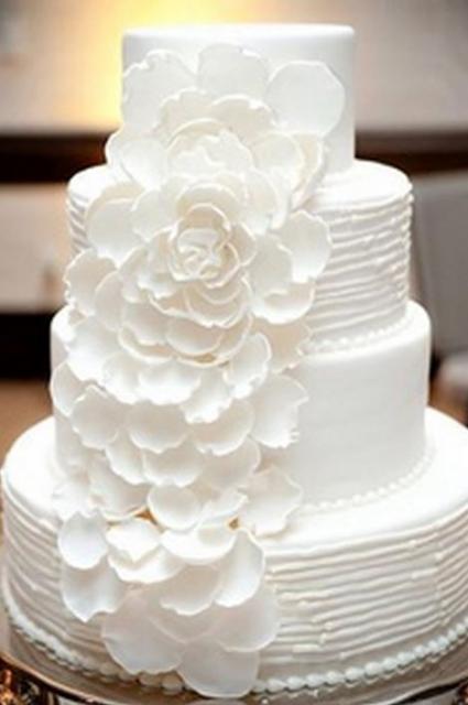 Bright White 4 Tier Round Wedding Cake With Cascading