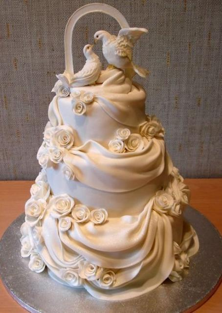 Doves And White Drapes 3 Tier Wedding CakeJPG 10 Comments