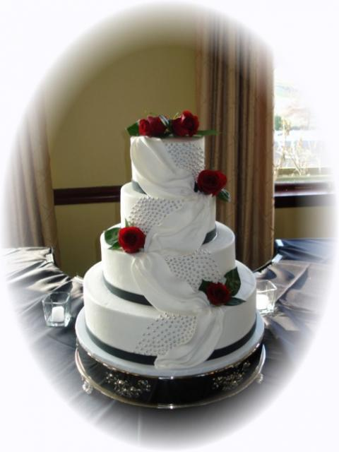 Elegant White Wedding Cake With Red Flowers 1 Comment