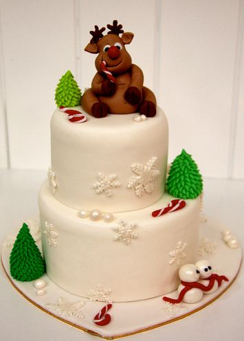 Two Tier Round White Christmas Cake With Reindeer On Top