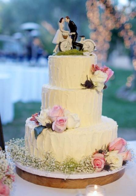 White 3 Tier Wedding Cake With Bride Groom On Bicycle