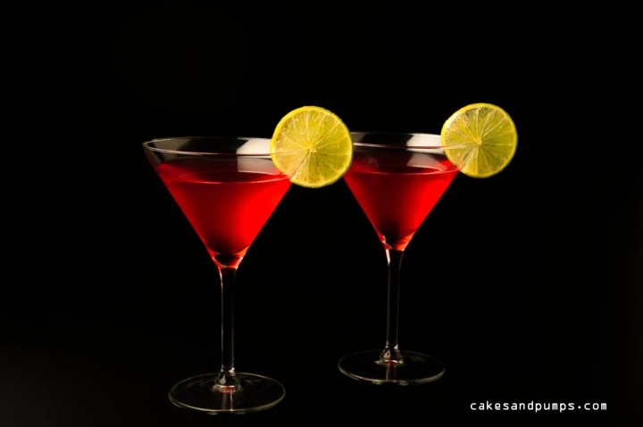 Cosmopolitan cocktail with vodka, triple sec and cranberry juice, photographed on black for cocktail friday