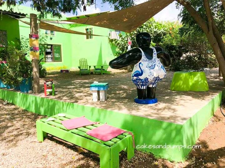 Part of the garden of Serena's art factory Curacao, cakesandpumps.com