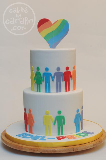 Rainbow-layered cake for Toronto Pride with LGBT bathroom figures