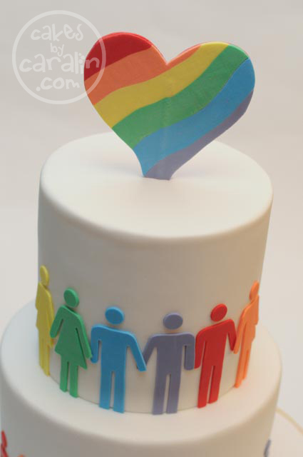 Rainbow-layered cake for Toronto pride with LGBT bathroom figures.