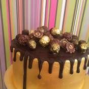 Gold farrero rocher drip cake