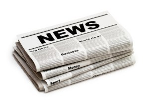 "a folded up newspaper with ""NEWS"" written on the top.  The newspaper has 4 visible sections all stacked on top of each other, on a white background."