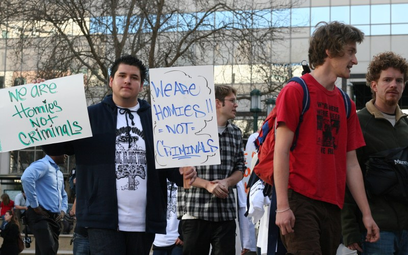 Signs from a gang injunction protest