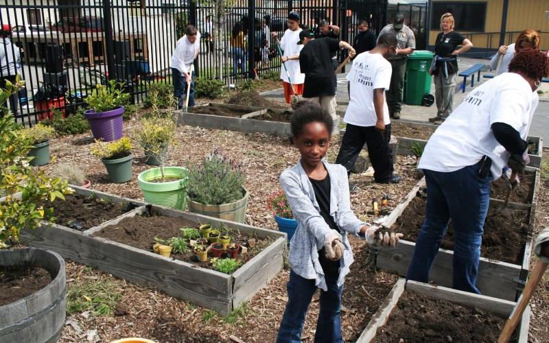 Amani Hill, 8, prepared soil beds on the schoolyards of Richmond College Prep School, where she attends elementary school.