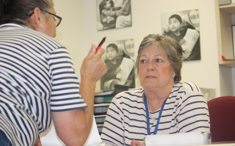 Pamela Norton, who runs Monterey County's only free clinic, consults with a volunteer