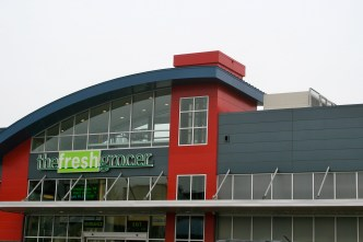 The facade of The Fresh Grocer, the North Philadelphia grocery store visited by Michelle Obama, and built with assistance from the Fresh Food Financing Initiative. Photo by Heather Tirado Gilligan.