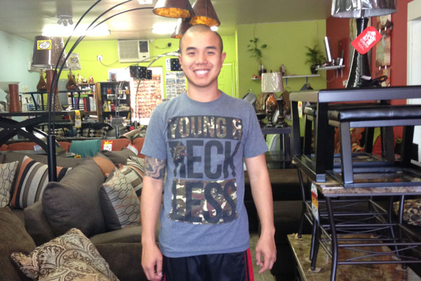Elvis Nguyen, 28, the owner of Nice Furniture, a small business in Long Beach, said having insurance has given him peace of mind. Photo: Jessica Portner/CHR